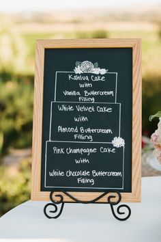 chalkboard with cake flavors #cakeflavors #diy #weddingchicks http://www.weddingchicks.com/2014/02/28/soft-summer-vineyard-wedding/