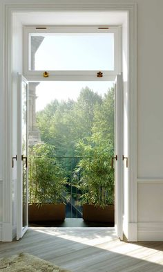 Doorway onto a small balcony in a Swedish apartment | Photo courtesy of Eklund Stockholm New York.