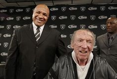 New Oakland Raiders head coach Hue Jackson, left, and owner Al Davis smile at a news conference at Raiders headquarters in Alameda, Calif. Davis was not shy about bringing in minority candidates as he hired the first African-American head coach (Art Shell), the first Hispanic head coach (Tom Flores) and the first female CEO (Amy Trask) in league history.