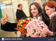 Moscow Region, Russia. 3rd Apr, 2017. Russian figure skater Evgenia Medvedeva (L), who has won the ladies competition at the 2017 ISU World Figure Skating Championships in Helsinki, Finland, during a welcome ceremony at Sheremetyevo International Airport. Medvedeva has broken her own world record total score with 233.41 points. Credit: Maria Antipina