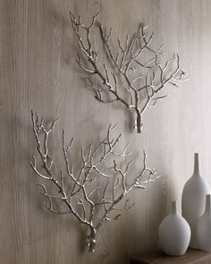 Tree Branch Wall Decor by Arteriors at Horchow.  Saw on hi-lo project. Pour silver oil base paint into tub of water. Drag branches thru for good coverage.