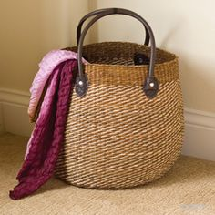 Sea Waves Basket Tote  Savvy, sophisticated round tote woven with waves of light and dark brown sea grass. Decorative and functional, with reinforced leather handles. 12 in. dia x 12 1/2 in. h, handles: 20 1/2 in. l    Item #92288  $40.00