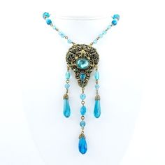 Beautiful Aqua Blue Czech Glass Drops and Brass Filigree Necklace from Vintage Jewelry Girl! #vintagejewelry #vintagenecklace #vintagejewellery #czechjewelry #czechnecklace