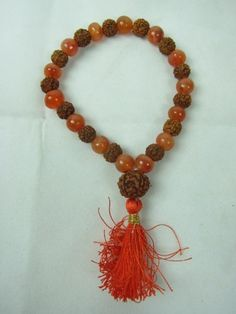 Rudraksha Carnelian Wrist Mala/ Bracelet for Meditation Jewelry- Stone of Confidence and Action mogul interior, http://www.amazon.com/dp/B00BBT497O/ref=cm_sw_r_pi_dp_fnOerb1JJBK8E