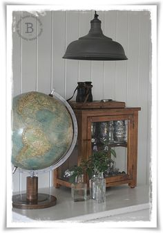 cool small display cabinet...and light...globes are coming in at American Home & Garden in Ventura, CA