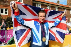 Gold medallist Bradley Wiggins of Great Britain celebrates after the victory ceremony after the Men's Individual Time Trial Road Cycling on day 5 of the London 2012 Olympic Games on August (Source: Pool/Getty Images Europe) Tour Of Britain, Great Britain, Leeds, Bradley Wiggins, Mark Cavendish, Saints, 2012 Summer Olympics, Olympic Gold Medals, British Sports