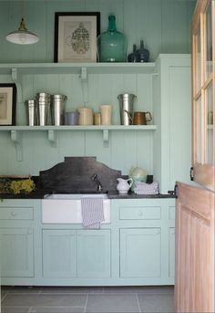Soapstone backsplash-- mediterranean laundry room Room of the Day: Southern Living Idea House laundry room