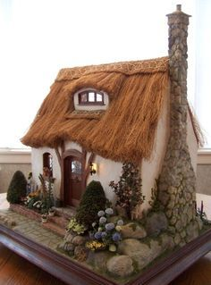 thatched cottage dollhouse - summer is time to harvest grasses.English cottage dollhouse by Teresa LaymanThis was the first miniature house I built after being inspired by the work of Rik Pierce . The design is mostly his, but I had to figure out how to a