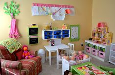 lovely idea for a REAL playroom. I think I am going to take some ideas for my girls new place to play at home. I love the tree to hang the apron the bin cases, the wall art display, uhhh everything is soooo real!