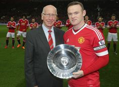 MANCHESTER, ENGLAND - DECEMBER 19:  Wayne Rooney of Manchester United is presented with an award by Sir Bobby Charlton to mark his 500th appearance for the club ahead of the Barclays Premier League match between Manchester United and Norwich City at Old Trafford on December 19, 2015 in Manchester, England.  (Photo by John Peters/Man Utd via Getty Images)