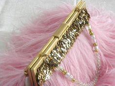 Onida Cruz pink feather handbag