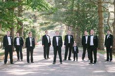 Groom + groomsmen in classic black tuxedos + white pocket squares + white boutonnieres {OLLI STUDIO}