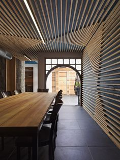 wood slat ceiling + wall treatement | hell of the north {by SMLWRLD via contemporist}: