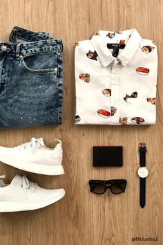 A woven shirt featuring an allover sushi print, a basic collar, a button-down front, a chest patch pocket, short sleeves, and a vented hem.