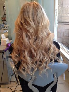 Glamorous wavey curls achieved in the salon using the new ghd eclipse styler.