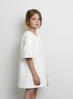 ss15: The elbow-grazing bell sleeves lend Lemoniez's pure white coat drama. www.tfnyusa.com, www.lemoniez.com