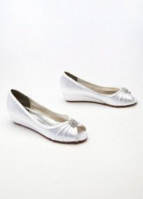 """These Dyeable shoes are both Stylish and comfortable, featuring a low wedge peep toe thatis a necessity for any season!  Wedge peep toe features sparkling rhinestone ornament.  Heel measures: 1 1/2"""".  Fully lined. Imported.  Dyeable shoes are sold in White as shown. Bring your dyeable shoes to your local David's Bridal Store to have them dyed in any of our exclusive colors.  About Dyeable Shoes."""