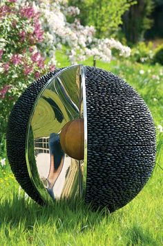 Kernal spherical sculpture in garden setting