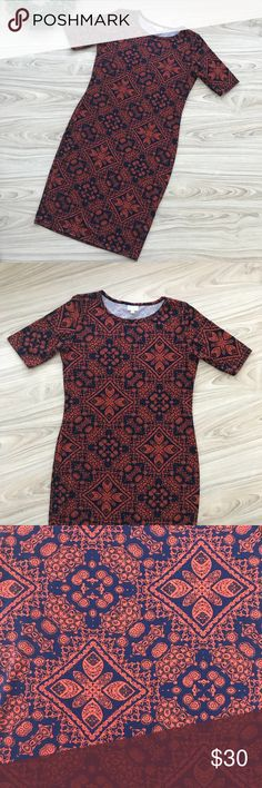 • LulaRoe • Julia Dress Sz M LulaRoe Julia Dress size Medium. It is dark blue with an orange pattern. It is light and stretchy and in excellent condition with no signs of wear. 96% Polyester, 4% Spandex || Shoulder to Shoulder: 14.5 inches || Bust: 18 inches || Total Length: 39 inches || LuLaRoe Dresses