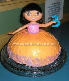 Homemade Dora Birthday Cake: For my daughter's 3rd birthday, we did this Dora birthday cake since it was her favorite character at the time. I found the 18 doll at Kmart and we baked