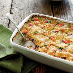Ham-and-Vegetable Cobbler | Pretty much anything goes in this catch-all cobbler. We made ours with ham, sweet peas, mushrooms, carrots, and a flaky piecrust. Feel free to add other veggies, or try turkey instead.