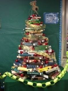 Christmas tree for a teacher. This photo was shared from PTA at Center Middle School in Ohio. Students and parents helped to create for the school. Great idea and the children had a lot of fun making it! (No books were harmed). :)