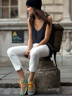 Cool model-off-duty style in pants, tank, trainers, and a beanie // Photo: The Styleograph #LFW #streetstyle