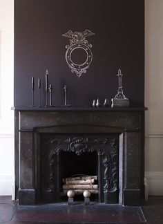 Can't decide on a piece of art for above the mantel? Change it all the time with Benjamin Moore Chalkboard Paint.