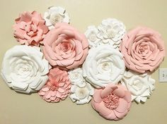 Its official, I've fallen head over heels in love with this paper flower wall! I love how everything comes together in the end, I didn't see it at first, but I kept truckin' on and voila!  The nursery for this customer is going to be absolutely perfect!  P.S. Would look beautiful for any room I a home or party!  Colors are easily customers to your request!