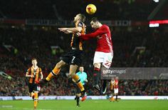 Henrikh Mkhitaryan of Manchester United and David Meyler of Hull City in action during the EFL Cup Semi-Final First Leg match between Manchester United and Hull City at Old Trafford on January 10, 2017 in Manchester, England.
