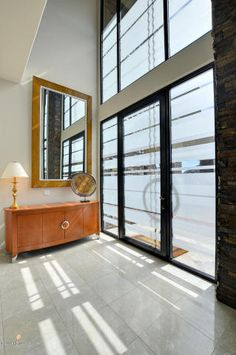 Check out this one of a kind glass and iron oversized front door. To enter be ready to fetch up $4 Million that's what this hillside contemporary estate is on the market for.