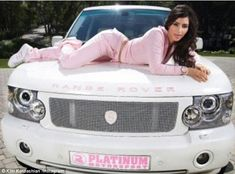 Kim Kardashian was a fan of Juicy Couture tracksuits, pictured in a pink velour style lyin...