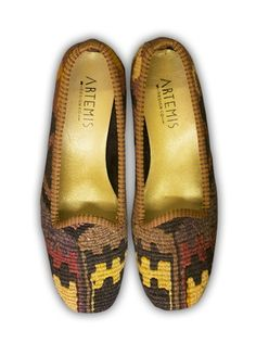 Artemis Design Co. couples unique, worldly textiles and classic design to create one of a kind handbags, shoes, and other accessories.  This comfortable and versatile Kilim flat is made from leather and vintage wool kilim carpet.  Each pair is completely one of a kind.  Also weekenders and handbags shoes