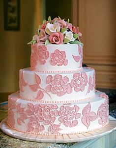 Tiers of rolled chocolate with pink buttercream piping echo the dress.  turn pink into champagne!