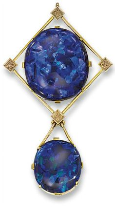 AN OPAL PENDANT  Of Arts and Crafts design, the principal oval-shaped black opal measuring 24.4 x 21.5 mm within an openwork lozenge frame with decorative square points suspending an opal drop measuring 17.7 x 15.7 mm, circa 1905, 6.5 cm long, in fitted brown leather case