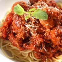 Crockpot Meat Sauce Recipe | Recipe4Living-Put on high for two hours and then low for three-hit the spot for some comfort food with American cheese underneath and parmesan on top