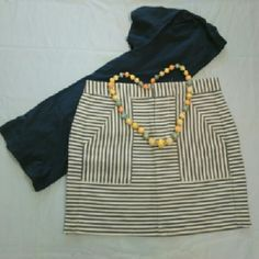 """Madewell Skirt This Madewell blue and cream-white striped skirt would look great with a white button up short sleeve blouse or a dark blue tee. It would pair great with tennis shoes or sandals. Dress it up or down, either way you will look good! Size 0, measures 15-1/2"""" from the front. (Necklace in picture also for sale separately) Madewell Skirts"""