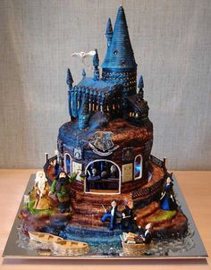 Check out Three Tiered Castles from 15 Amazing Harry Potter Themed Cakes