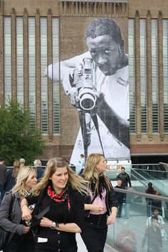 Street Art at the Tate Modern London and Walking Tour nearby. (Ladj Ly with a movie camera, by JR)