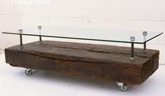 Railway tie coffee table.  This would look good with a shutter or wood plank topper.