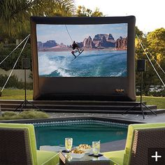 Inflatable Outdoor Projector Screen!  What could be better than watching movies in the pool!  Can't wait~Pool Parties!