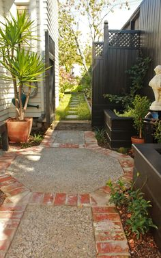 ** like recycled brick edging** Cute Concrete Courtyard with Recycled Brick Edging - Remuera