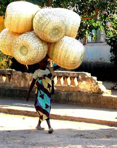 Africa | Woman bringing baskets to the Market.  Angola.  | © Nate Miller