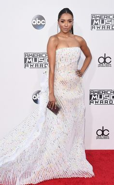 Kat Graham from 2015 American Music Awards: Red Carpet Arrivals  This Vampire Diaries starlet is having a major fashion moment in her Georges Chakra sheer skirt paired with a a ring by L'Dezen by Payal Shah.