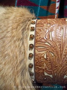 Ivory and amber #leather filigree overlay, Colorado Red Coyote fur, and solid brass conchos with amber stones make this #Western style #pillow a Stargazer Mercantile favorite!