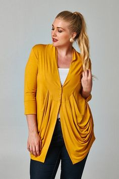 Plus size 3/4 sleeve and 3-button mustard cardigan. We love the simplicity of this cardigan and its casual chic look! Material: 95% rayon, 5% spandex. Sizes 1XL-3XL. Made in USA ♥