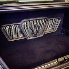 car audio custom install trunk mesh sub enclosure walled off logo