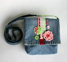OOAK upcycled small denim messenger bag lined with rose print fabric. $40.00, via Etsy.