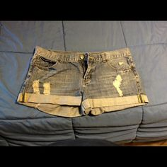 Cuffed jean shorts Great shirts, cuffed, but have a stain on the front. Good condition. Tag says 12 but they fit more like a 10 2.1 jeans Shorts Jean Shorts