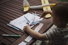 boy 3-year-old toys plane documentary style family photography inspiration